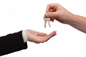 816762-man-handing-over-woman-set-of-keys